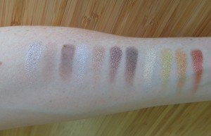 First three columns of shadows swatched from left to right.  The matte, cream is barely visible on my skin!