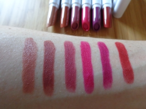 Swatches from left to right: Chocker (creme), Mosh Pit (matte), Baewatch (matte), Out of Sync (matte), Too Sexy (satin), TGIF (matte).