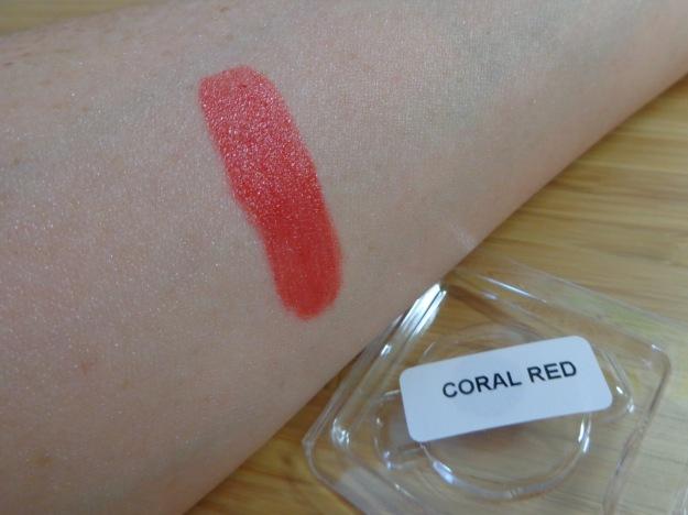 Zuii Organic coral red lipstick swatch.